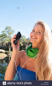 young attractive 50 year old woman listening to music on cell