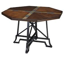 brown wooden octagon dining table plus black steel legs placed on