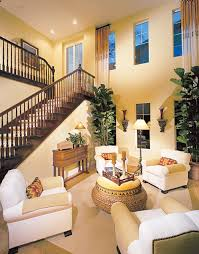 photos of two story living rooms with stairs with beautiful