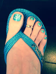 pretty pedicure a shimmery turquoise polish with white flowers