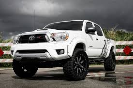 super clean lifted toyota tacoma on black rhino off road wheels