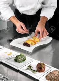 Professional Kitchen Chef Preparing Food On Professional Kitchen In Restaurant Stock