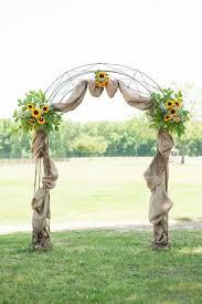 wedding arches decorated with burlap western wedding arch
