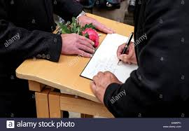 memorial service sign in book hamburg germany 8th july 2015 mourners sign a condolence book