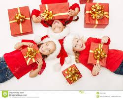 christmas kids opening present gift box children in santa hat
