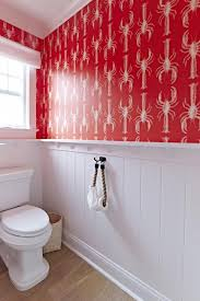 bright red wallpaper with a lobster print covers one half of the