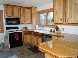 hand crafted custom rustic cedar kitchen cabinets by king of the