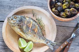 dorade cuisine grilled dorade royale fish with brussel sprouts stock photo
