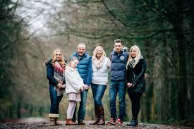 family photo shoot at castle coch taking photos in light