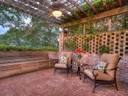 rustic patio with raised beds u0026 exterior brick floors in austin
