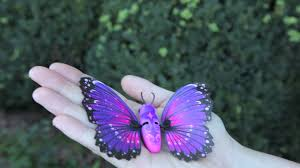 live pets butterfly flaps hand