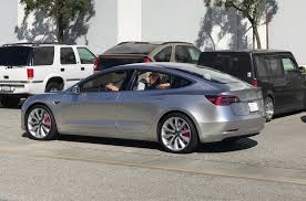 tesla model 3 reservations holders would rather wait for dual