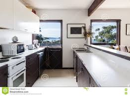 Beach House Kitchens by Older Style Retro 70s Kitchen In Australian Beach House Stock