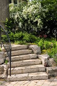 Rock Garden Steps by Landscaped Front Yard With Natural Stone Steps Stock Photo