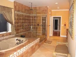 mediterranean master bathroom with frameless showerdoor u0026 powder