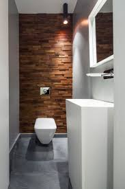 how to make a small apartment bathroom look bigger dark feature