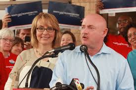 gabby giffords and husband mark kelly in northside parade wvxu