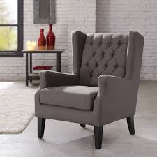 this classic wing chair with its button tufted detailing and