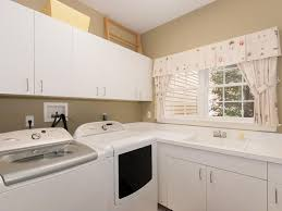 contemporary laundry room with built in bookshelf in wilton ct