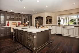 kitchen with white cabinets and dark flooring most favored home design