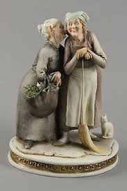 Capodimonte Tramp On A Bench Pin By Viorica On Capodimonte Figurine Pinterest Porcelain And