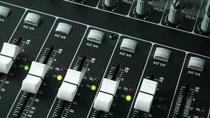 Sound Desk A Sound Engineer Using A Mixing Desk Or Mixing Console To Mix A