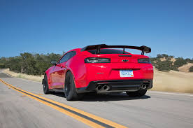 2018 chevrolet camaro zl1 1le rear three quarter in motion 02