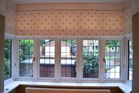 clarke u0026 clarke embroidered spot fabric on 3 roman blinds in a