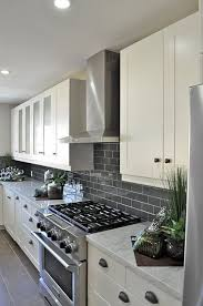 backsplash with white kitchen cabinets gray glass subway tile grey tiles glass doors and draw