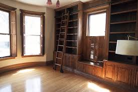 Builtin Bookshelves by The Built In Bookshelves And Rolling Ladder In The Library