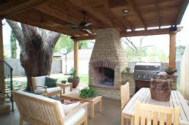diy outdoor living room brown stone fireplace white fabric canopy