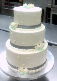 tiered wedding cakes 3 tiered wedding cake silver ribbon sunflower bakery
