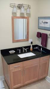 black syained wooden bath vanity with white marble countertop and