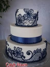 midnight blue wedding band 3 tier wedding cake with navy blue midnight blue line work flowers