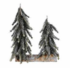 two small faux pine snowy christmas trees on log base tabletop