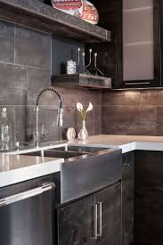 59 best kitchen backsplash images on pinterest kitchen large bold kitchen sink in grey rustic modern kitchen modern home in eugene oregon by jordan iverson signature homes