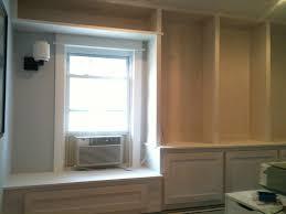 Window Seat Bookshelves Long White Wooden Bookshelves Beside White Wooden Window Seat