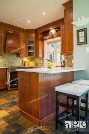 modern kitchen with cherry wood cabinets kitchen with earth tone slate flooring cherrywood cabinets