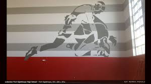 kat morris murals best chattanooga mural painter on the opposite wall from the cheerleading mural this wrestling mural painted in 2013 is actually clip art spec d out by the architects painted huge