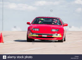 red nissan car a 1990 red nissan 300zx in an autocross race at a regional sports