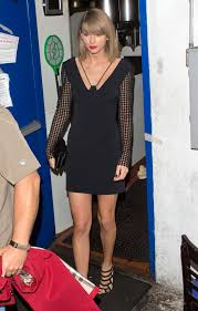 taylor swift in black bandeau and leather skirt fashion and