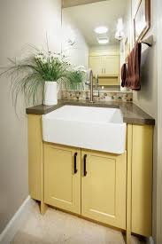 farmhouse sink vanity powder room with white walls traditional