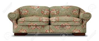 an old vintage sofa with a green and red floral fabric on an