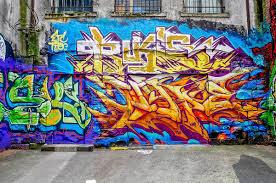 surprising vancouver street art travel addicts multi colored graffiti tag on brick wall