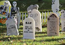 halloween headstones a graveyard decorating a lawn for halloween stock photo picture