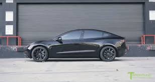 blacked out tesla model 3 looks set to do a drive by shooting