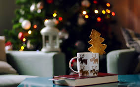 new year picture books mug cup cookies book christmas tree lights garland new