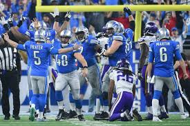 detroit lions beat vikings on thanksgiving lead nfc