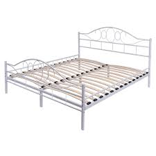 white steel bed frame with wood slats and arched headboard beds