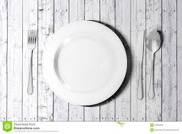 3d table setting with empty plate and cutlery stock